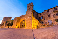 Medieval entrance of Monticchiello at sunset, Tuscany Stock Photos