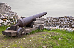 Medieval era castle in South Europe. With an old gun Stock Image