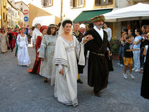 Medieval Europe. People in medieval costumes walking in the streets celebrating the medieval festival SERATA MEDIEVALE, Cantiano, Italy, 17. August 2008 Stock Photo
