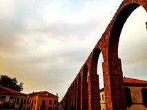 Medieval european abbey and aqueduct. Monastery of Santa Clara i royalty free stock images