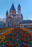 Medieval european church with flowerbed outside Stock Photography