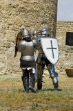 Medieval european knight near citadel. Medieval european knights fighting near citadel wall Stock Photography