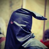 Medieval EXECUTIONER with the black cap on his head Royalty Free Stock Photos