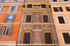 Medieval facade of house on street in Rome city Royalty Free Stock Image