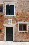 Medieval facade of the old building in Venice Stock Photos
