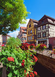 Medieval fachwerk houses at Tanners district. COLMAR, FRANCE - AUGUST 21: Medieval fachwerk houses at Tanners district in the center of Old Town on August 21 Royalty Free Stock Images