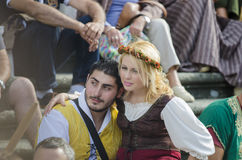 Medieval Fair in Galicia Spain. PONTEVEDRA, SPAIN - SEPTEMBER 6, 2014: A group of people dressed in costumes from the Middle Ages, enjoy one of the shows on the Stock Images