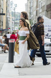 Medieval fair. PONTEVEDRA, SPAIN - SEPTEMBER 6, 2014: A young girls walking, dressed in colorful costumes of the Middle Ages, in medieval festival held each year Royalty Free Stock Photo