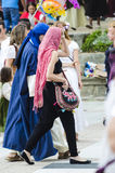 Medieval fair. PONTEVEDRA, SPAIN - SEPTEMBER 6, 2014: A young girls walking, dressed in colorful costumes of the Middle Ages, in medieval festival held each year Stock Image