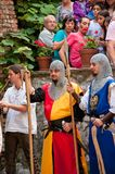 Medieval fair and tourists at Bran castle. Actors dressed in medieval costumes acting in front of an audience at Bran castle in Romania Stock Photography