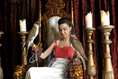 Medieval fantasy princess with two falcons Stock Photos