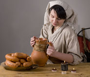 Medieval or Fantasy tavern serving girl with sausa Stock Photo