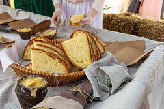 Medieval fast food slice of bread large rustic loaf ceramic bowl of honey and lard with garlic nourishing additive delicious snack stock photo