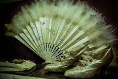 Medieval female clothing accessories. Such as fan and high heel shoes Royalty Free Stock Image