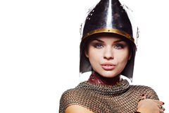 Medieval female knight in armour. Portrait of a medieval female knight in armour Stock Images