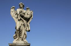 Medieval figure of an angel on the famous bridge Saint Angelo br Royalty Free Stock Photos