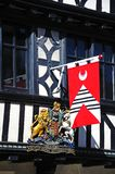 Medieval flag on Tudor building, Tewkesbury. Stock Image
