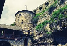 Medieval Forge Tower. View to the fortification tower from courtyard of a medieval forge. Architectural ensemble of antique Kamianets-Podilskyi Castle in Ukraine stock photos