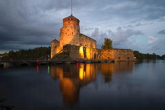 The medieval fortess in Savonlinna in the twilight. Finland. The medieval fortess in Savonlinna in the summer twilight. Finland stock photos