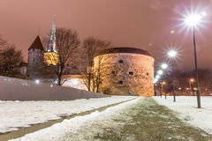 Medieval fortification tower with church on background. Old fat defence tower in Tallinn, Estonia Stock Photo