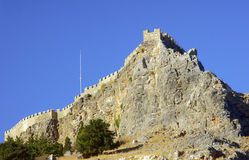 Medieval fortifications on top of the rock Stock Photos