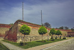 Medieval fortified walls and ornamental trees Royalty Free Stock Photo