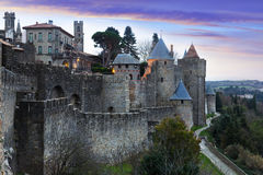 Medieval  fortness walls in evening time.  Carcassonne Royalty Free Stock Photos
