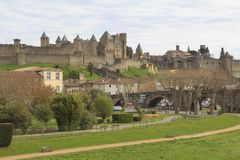 Medieval fortress in Carcassonne. CARCASSONNE, FRANCE: MARCH 29, 2018: View of the medieval Citadel and bridge over river Aude in Carcassonne, France Royalty Free Stock Images