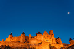 Medieval fortress in Carcassonne illuminated Stock Photos