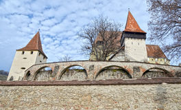 Medieval fortress. Fortified church with three protecting walls Stock Photos