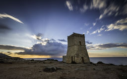 Medieval fortress on the hill at golden bay at Sunset, Malta, Europe. Long Exposure Royalty Free Stock Photos