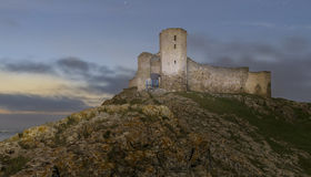 Medieval fortress. On mountains in Romania.Night scene Stock Photo
