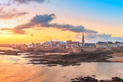 Medieval fortress Saint-Malo, Brittany, France. Walled city Saint-Malo with St Vincent Cathedral at sunrise at high tide. Saint-Maol is famous port city of stock image