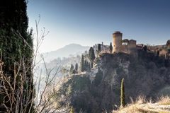 Medieval Fortress and Sanctuary among cypress trees royalty free stock photo