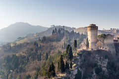 Medieval Fortress and Sanctuary on misty hills stock photo