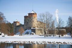 Medieval fortress of Savonlinna in the March landscape. Finland stock photos