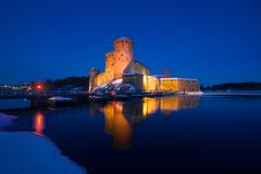 Medieval fortress of Savonlinna in the winter night landscape. Finland royalty free stock photography