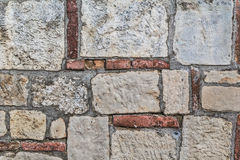 Medieval Fortress Stone-Brick Rampart Detail. Old medieval fortress rampart, made of carved stone and red brick, detail Stock Photography