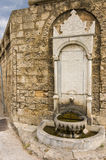 Medieval fountain with frescoes Stock Image
