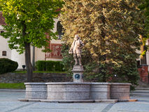 Medieval fountain with statue of Vratislav z Pernstejna, Czech republic. Ancient fountain in Nove Mesto na Morave, Czech republic royalty free stock photography