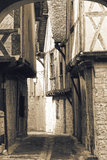 Medieval French Street. Sepia photograph of medieval French cobbled street in the village of Issigeac in the Dordogne region of Acquitaine Southern France royalty free stock photos