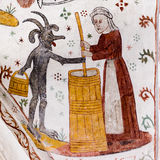 Medieval Fresco of a woman churning Butter with the Devil. Tingsted church, Denmark - April 11, 2017 stock photo
