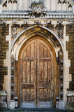 Medieval front doors. Medieval brick wall with wooden doors Stock Image