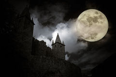 Medieval full moon. Medieval european castle in a full moon night. Added some digital noise royalty free stock image