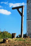 Medieval gallows. Place of execution with medieval gallows with clouds and blue sky as background Royalty Free Stock Photos
