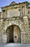 Medieval gate. Medieval gate with open door royalty free stock images