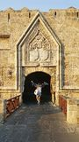 Castle of Rhodes. A medieval gate of the Castle of Rhodes with a woman stock photo