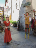 Medieval girl and jocker. TALLINN, 20 June 2012 - a medieval maid and a joker posing in front of the Medieval restaurant Olde Hansa in Tallinn, 20 June 2012 Stock Photo