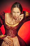 Medieval girl in the maroon dress Stock Photos