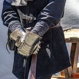 Medieval gloves of a knight, for protection made entirely of metal royalty free stock photos